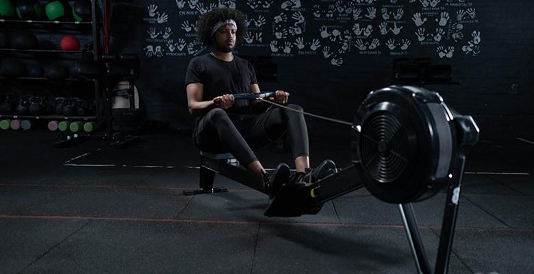 man sitting on rowing machine 2